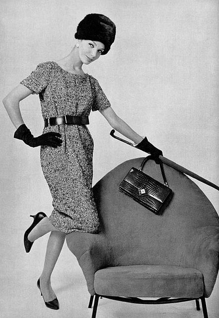 1958    Model is wearing an outfit by Pierre Cardin, shoes by Charles Jourdan, purse by Hermès and gloves by Roger Fare.