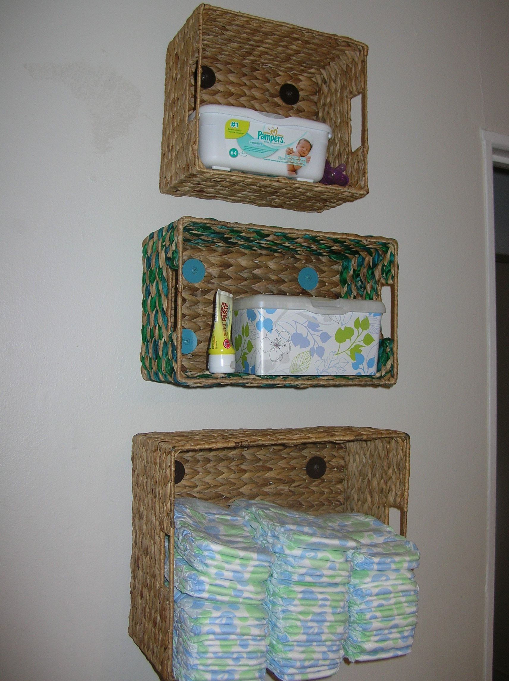 Diaper/Changing station storage. On the wall. Too high for ...