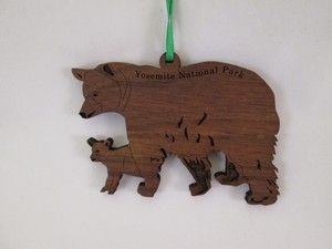 Wooden Bear Ornament: celebrate the season with this wooden black bear and cub ornament. Made in the USA from sustainably harvested black walnut and says 'Yosemite National Park'.