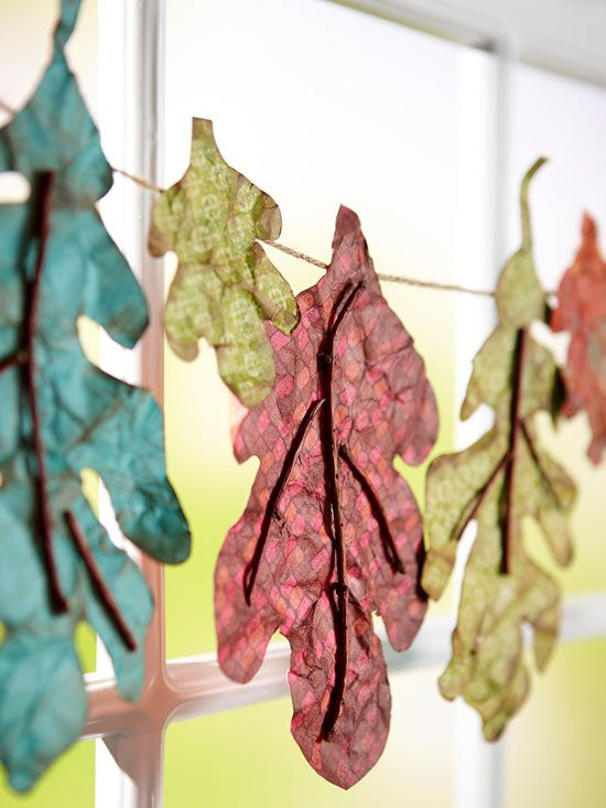 Use tissue paper and twigs to make this Leafy Window Banner. Learn how here:  http://www.bhg.com/decorating/seasonal/fall/easy-fall-decorating-projects/?socsrc=bhgpin081812fallleafbanner#page=6