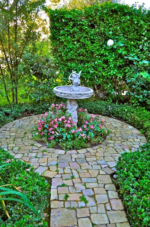 Bird baths sometimes have little adornments attached. Some ...