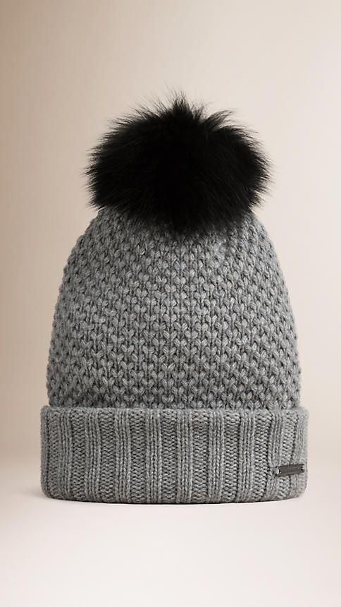 04984ad79c9 Burberry Soft wool cashmere beanie with a fur pom-pom Engineered in  contrasting textured and ribbed stitches Turnback hem. Discover more  accessories at ...