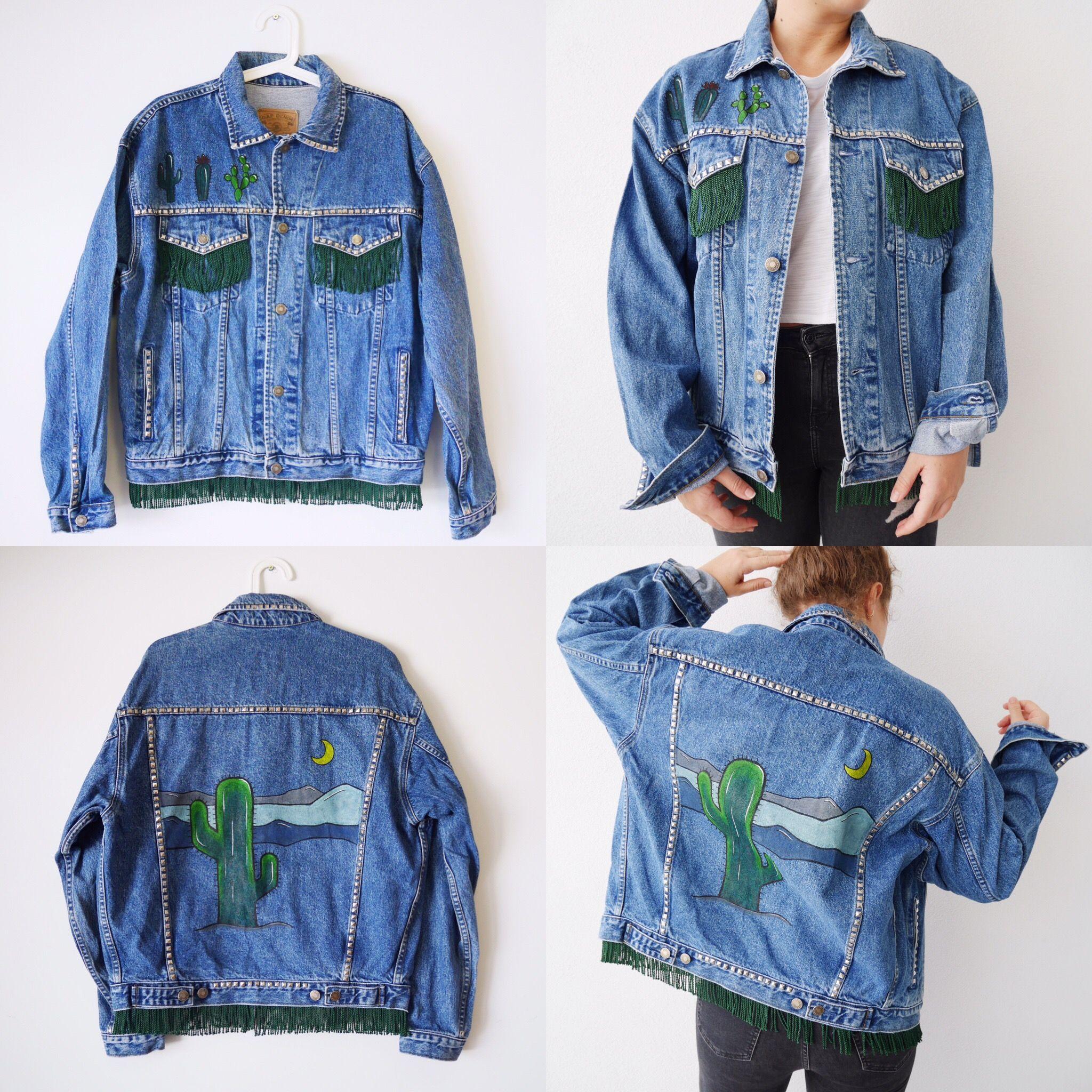 Hand Painted Oversized Vintage Denim Jacket On Etsy Cactus In Desert With Studs And Fringe Jean Jacket Outfits Painted Denim Jacket Diy Denim Jacket