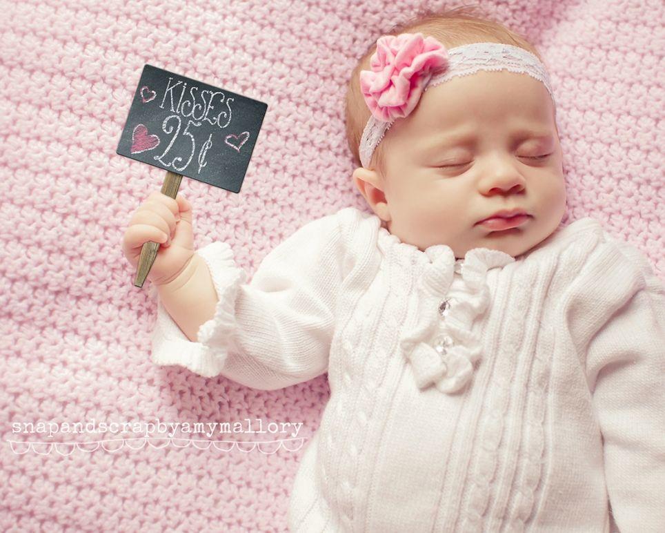 sweet 10 week old baby girl. Holding chalkboard sign from  designerdigitals.com