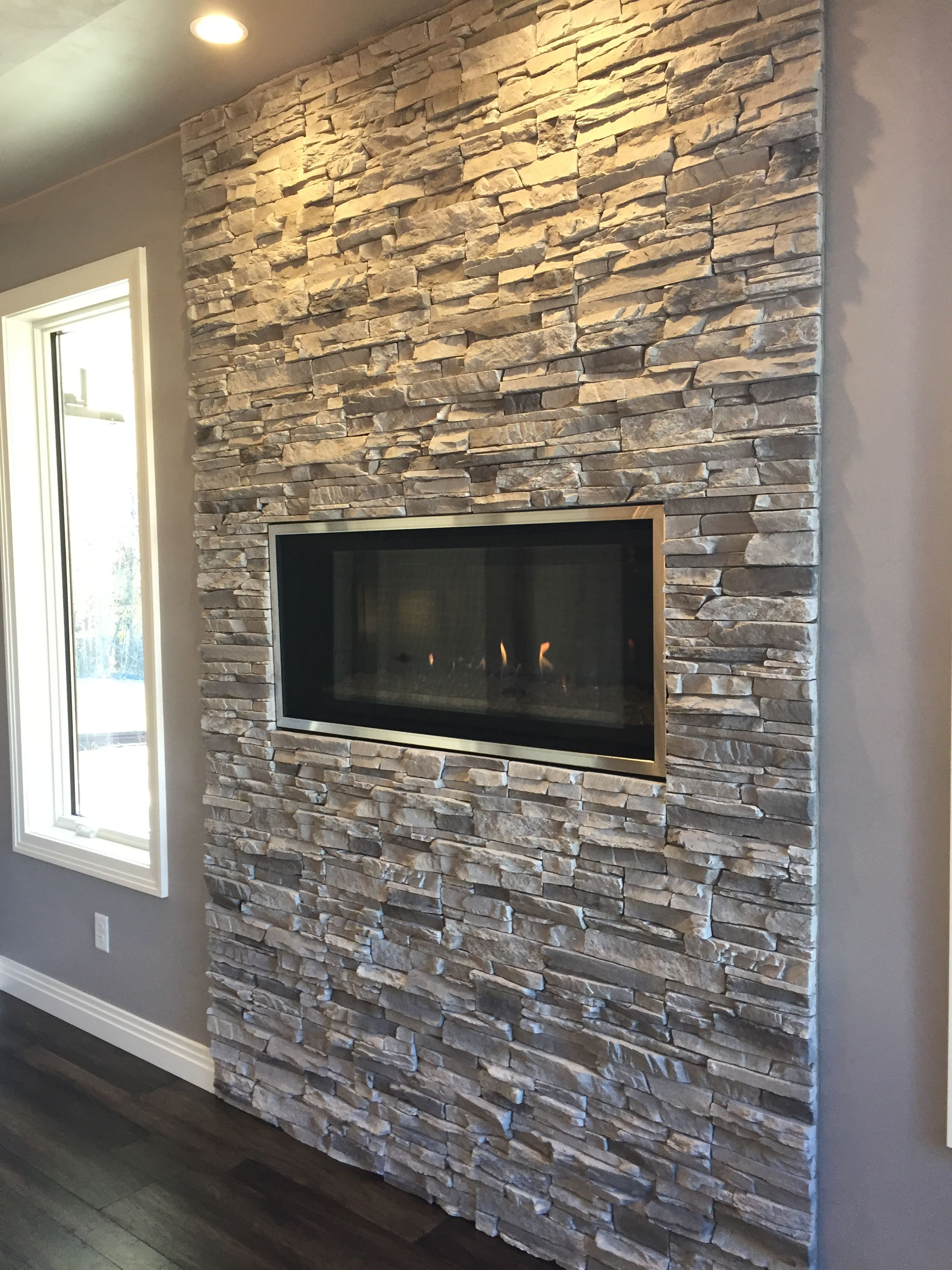 Contemporary Linear Fireplace With Silver Lining Stacked