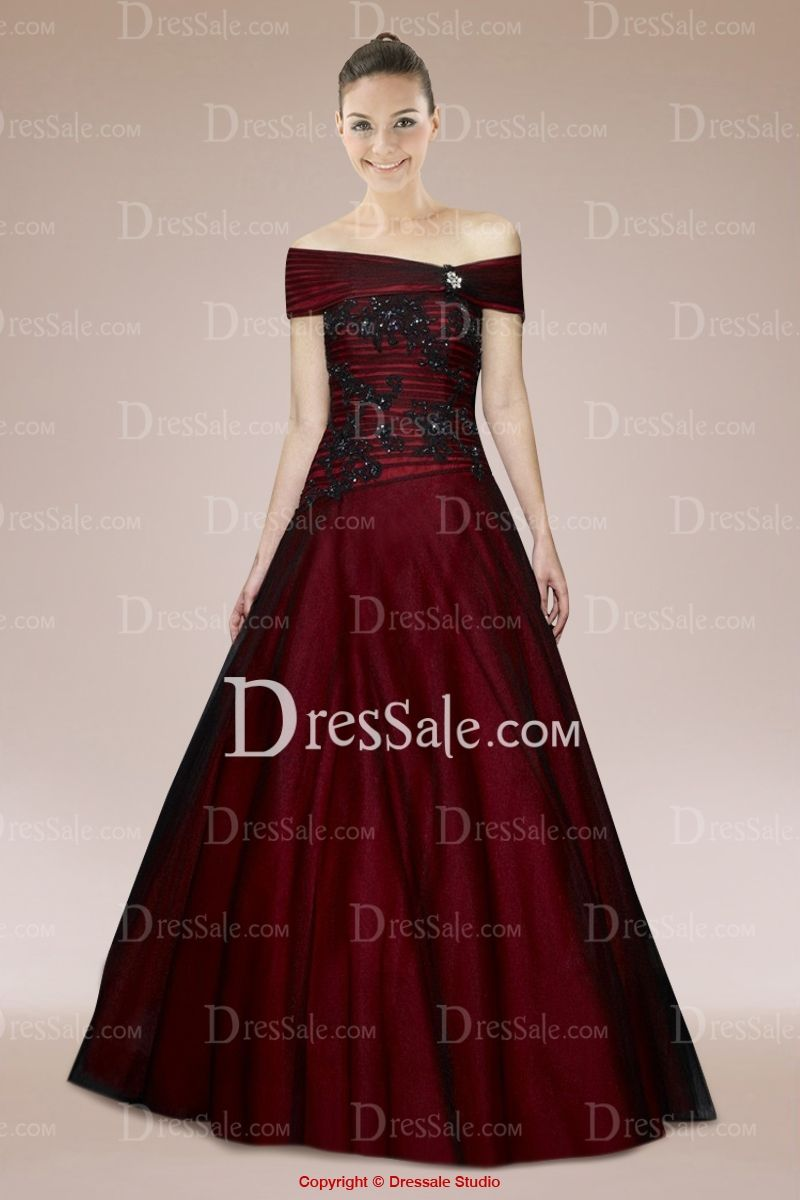 Burgundy dress in strapless backless style with applique brooch for