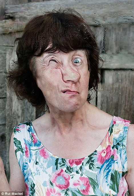 Watch out for that window! Photographer captures bizarre images of people distorting their faces using glass panes