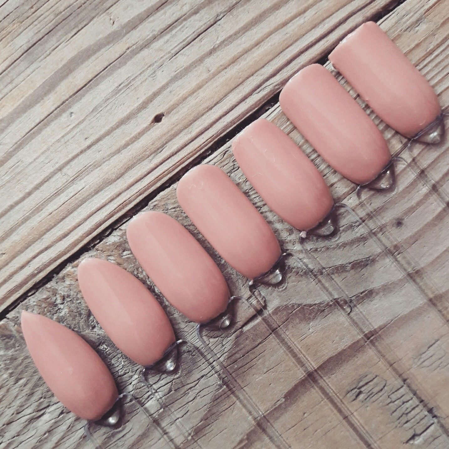 Different naill shapes with nailpolish up in the air-heart. Of ...