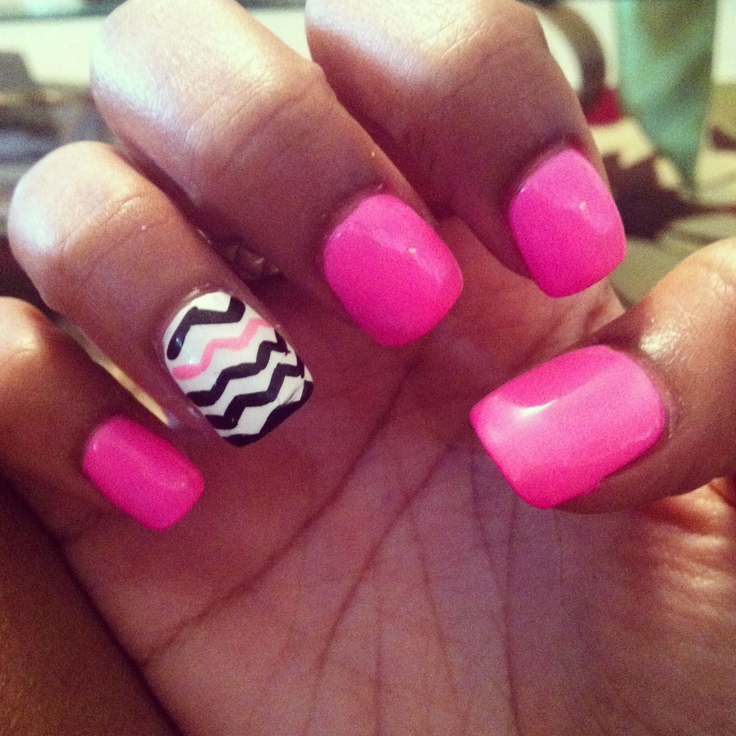 Hot pink nails with a black and white chevron print accent ...