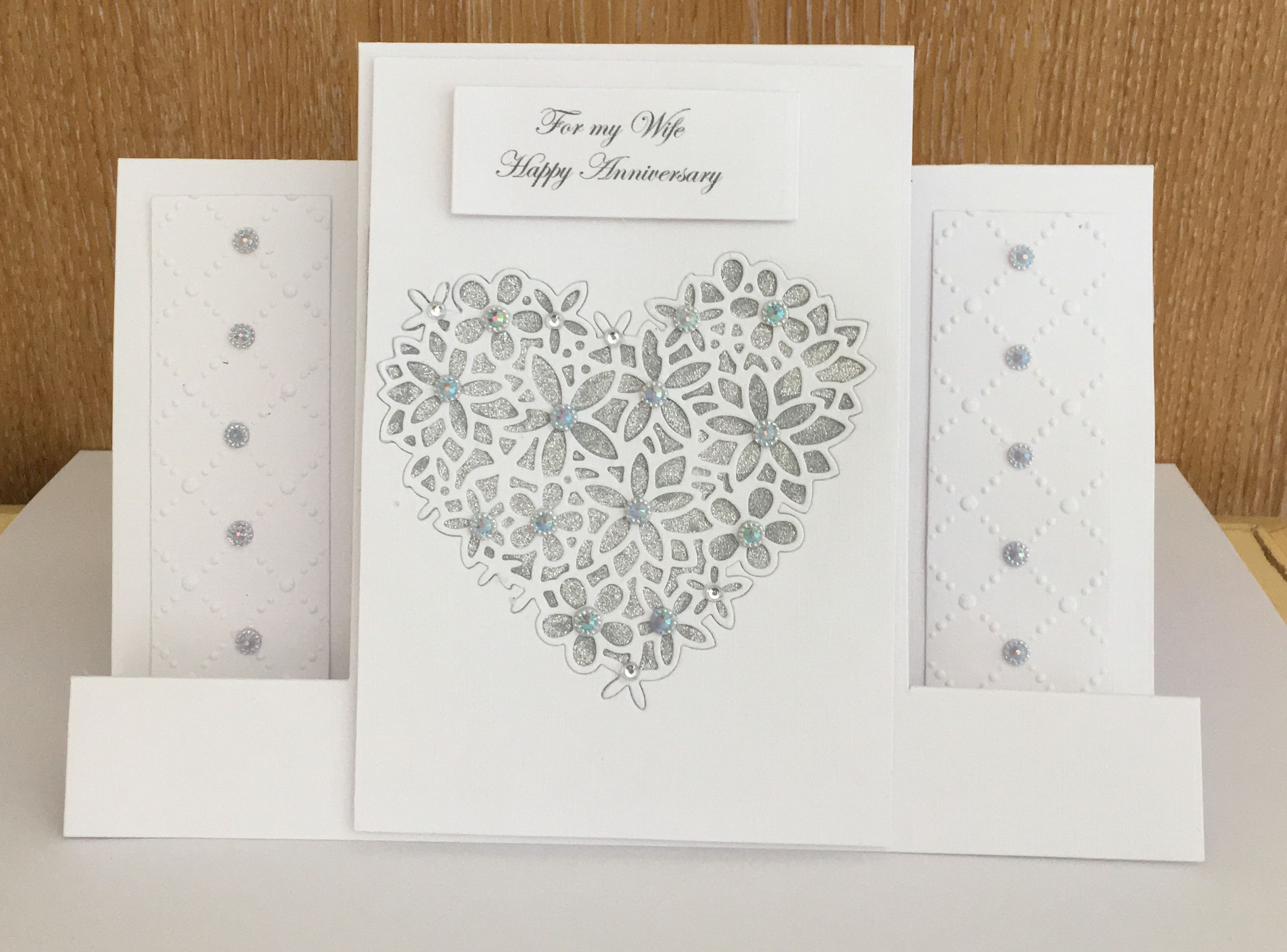 Handmade wedding anniversary stepper card made using tattered lace