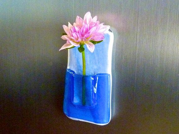 I like the idea of these small pocket vases - magnets/cubicle decor/smaller spaces