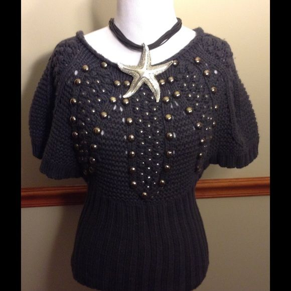 FABULOUS KNIT SWEATER WTH STUDS BY SO WHAT USA HOT! This knit sweater is eye catching and super cute! The studs make it POP!!! The color is  grey and it has short sleeves. Size small... GENTLY USED Sweaters