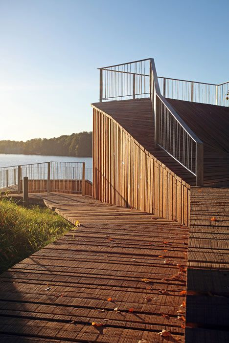 Wooden viewing platform looks out over Latvia's River Daugava/  by Latvian studios Didzis Jaunzems Architecture and Jaunromans un Abele