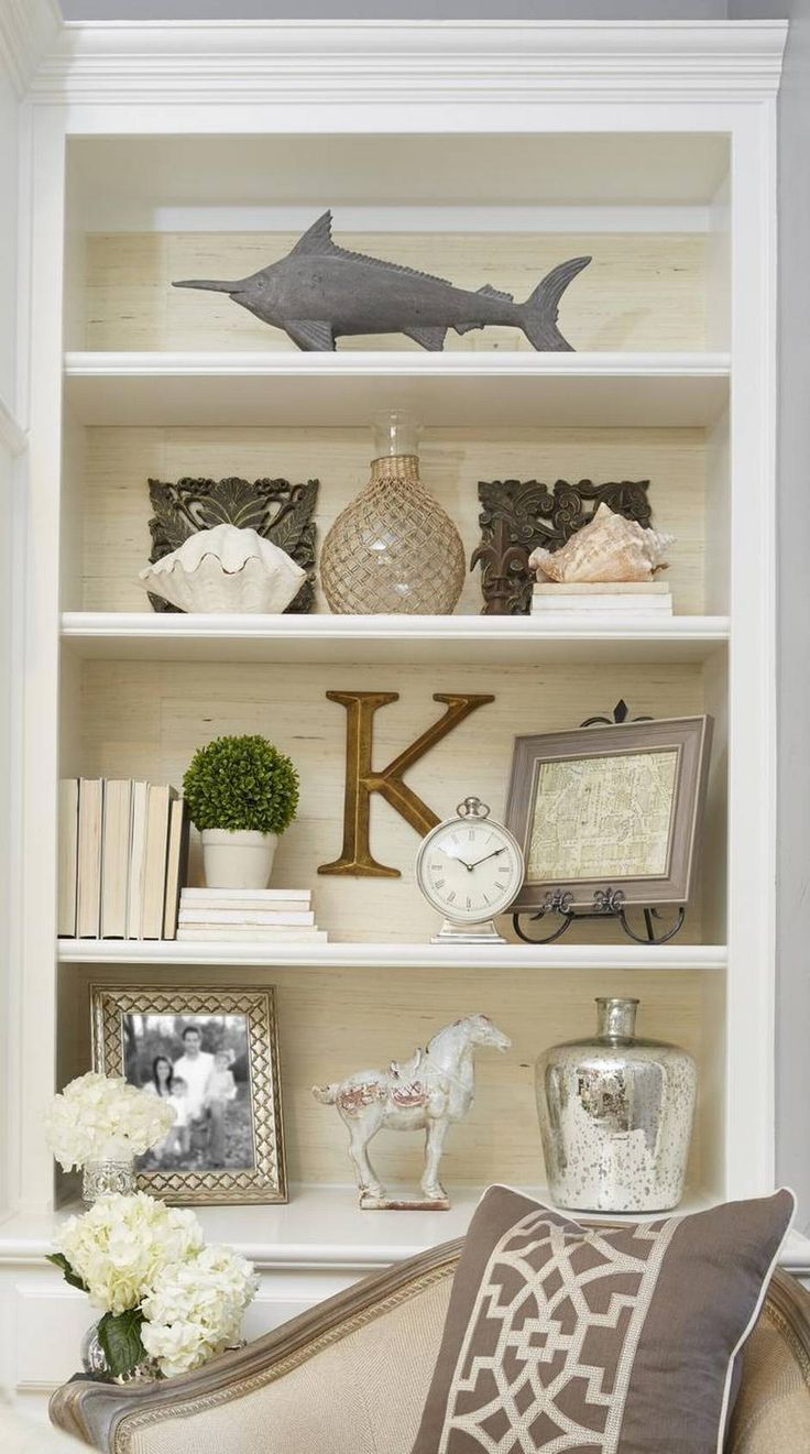 Living Room Built In Decorating Ideas Modern Curtains For Uk Create A Bookcase Piled High With Personality And Style Home The Key To Good Looking Is Making Sure There Enough Dimension Also Wallpapering Back Of Shelves Doesn T Hurt Either