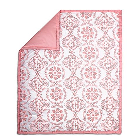 This Medallion Quilt design from The Peanut Shell is made of soft cotton sateen and features a medallion pattern in coral on white, reversing to a coral and white mini-dot. It's a stylish and comfy nursery accent, perfect for cuddling, tummy time, and more.  Can't wait to get this in our baby girl's bedroom!