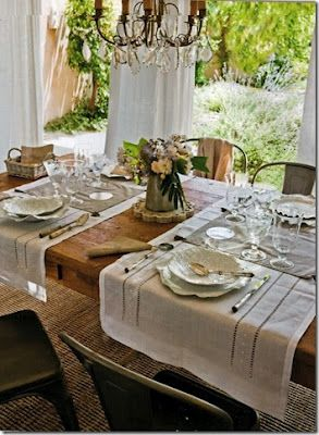 Use old linen curtains found at flea markets to set a rustic table....