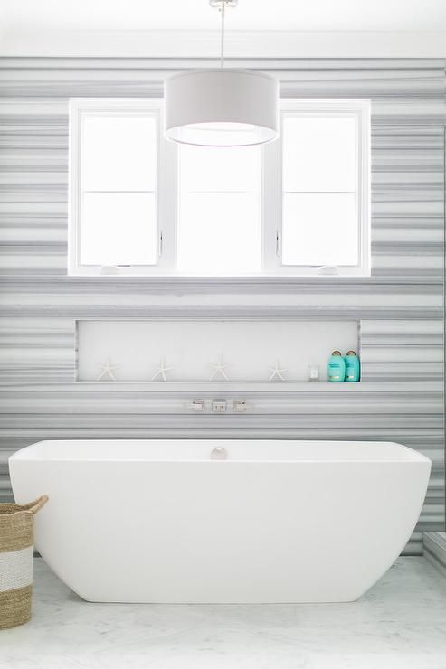Cool A window framed by a wall covered in Delano Marble is positioned above a niche located behind a modern freestanding tub placed on a white marble floor and Style - Review Bathtub Wall Inserts