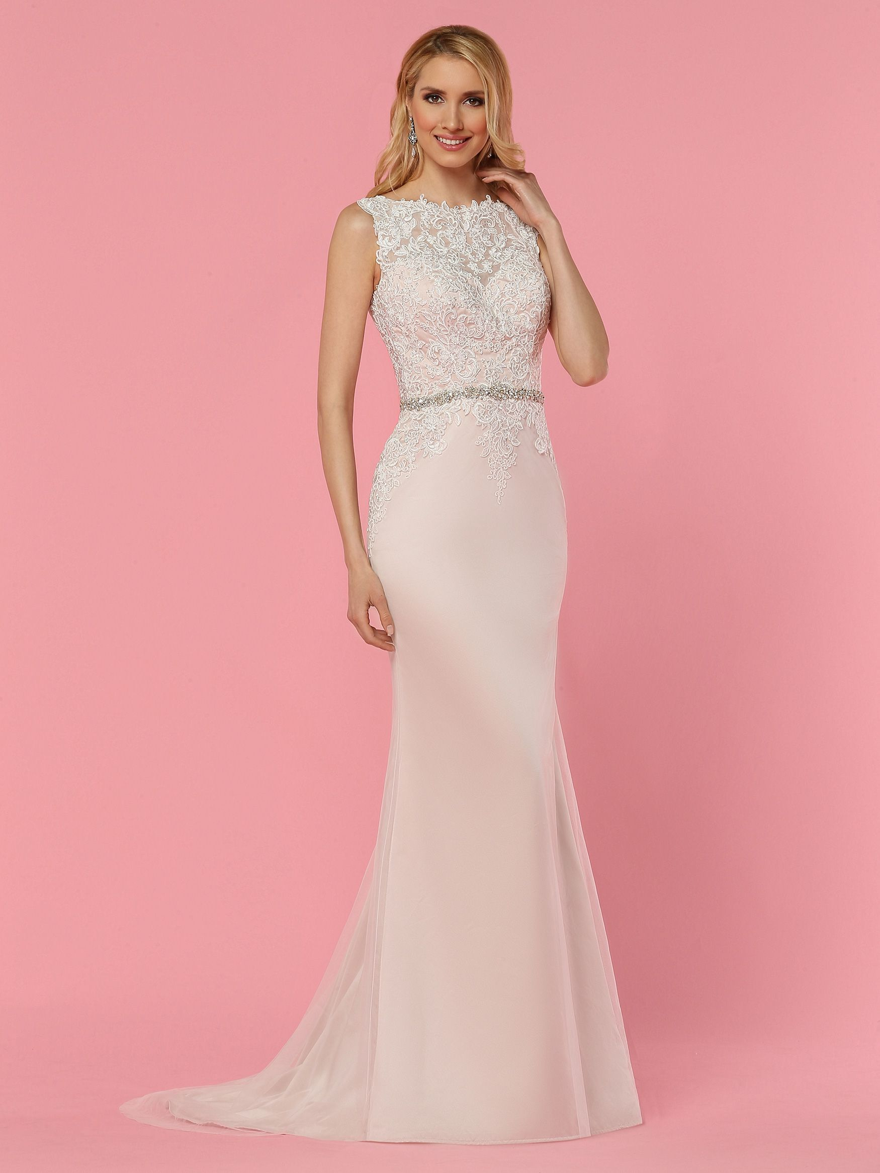 A lush lace bodice combines with a minimalist soft tulle skirt in ...