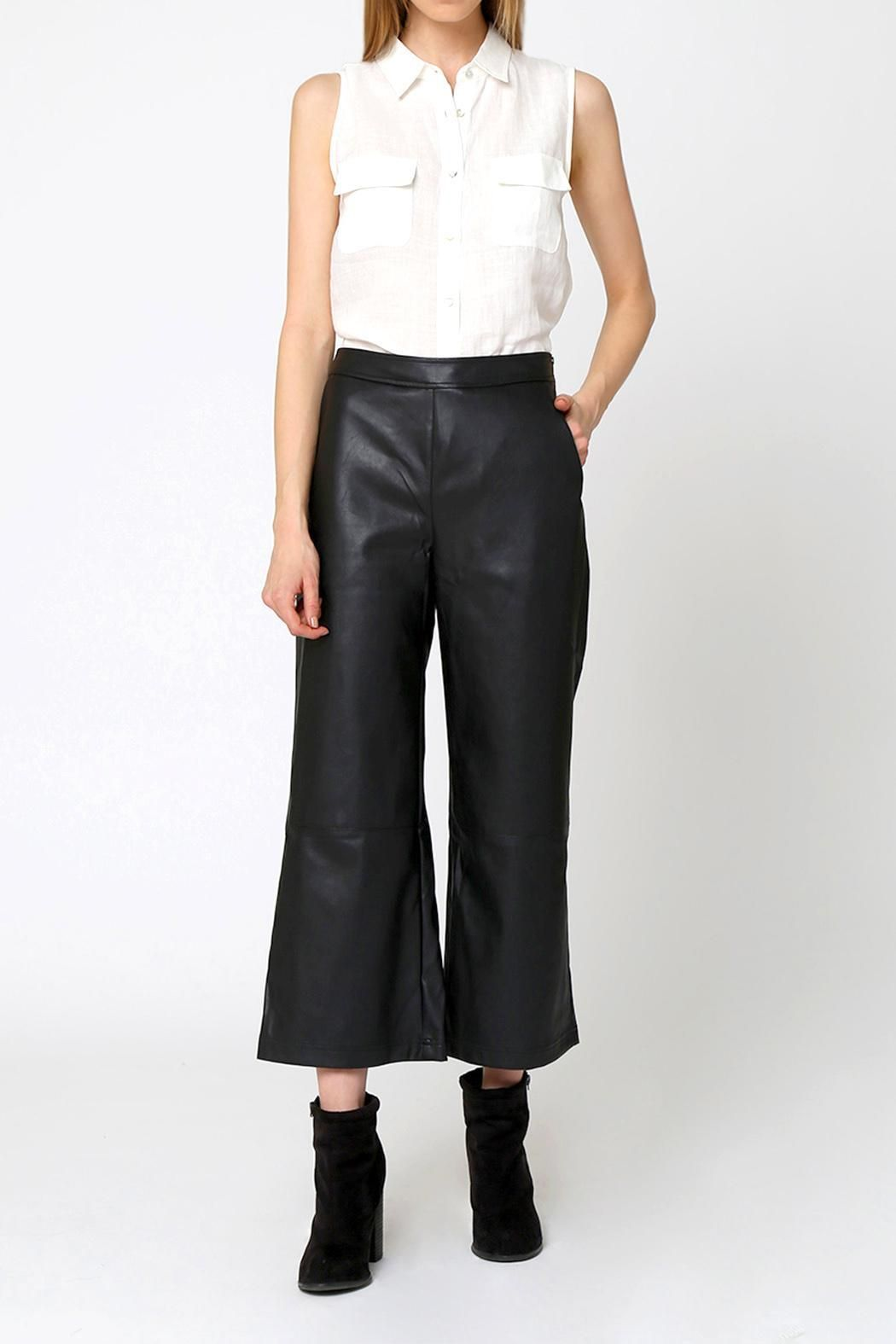 Vegan leather, black high waisted pants with a wide leg and cropped length.    Vegan Leather Wide-Leg Pants by Movint. Clothing - Bottoms - Pants & Leggings - Flare & Wide Leg Clothing - Bottoms - Pants & Leggings - Black Clothing - Bottoms - Pants & Leggings - Leather Los Angeles, California