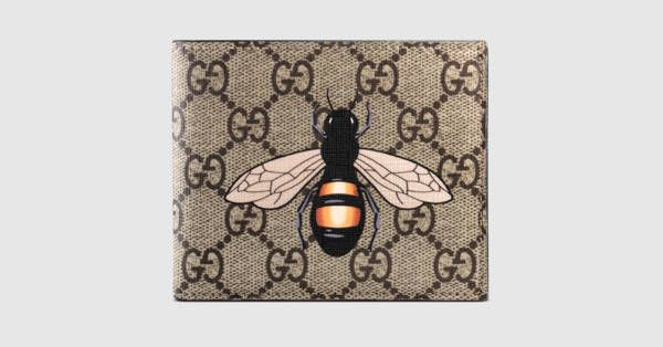 2d624534756 Gucci Bee print GG Supreme wallet