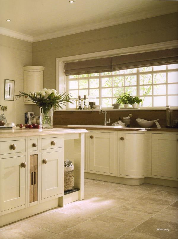 Classic Ivory Shaker Style Kitchen With Curved Cabinets For The