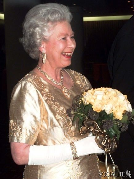 November 19th, 1997-Queen Elizabeth, looking radiant in a golden dress, attends a Royal Gala at the Festival Hall to celebrate her Golden Wedding.