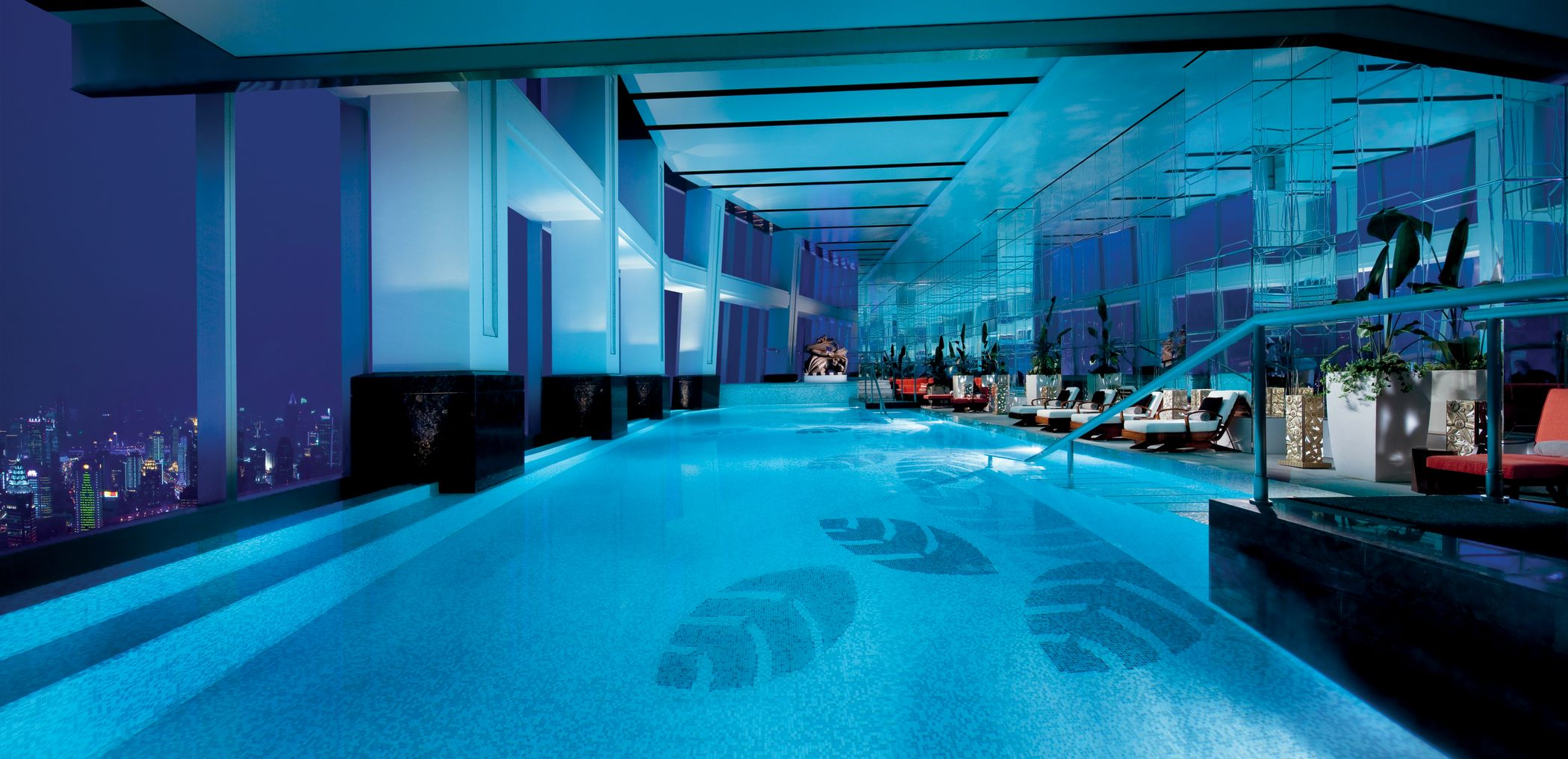Enjoy The Serenity And Relaxation At The Heated Indoor Infinity Pool With Sweeping City View At