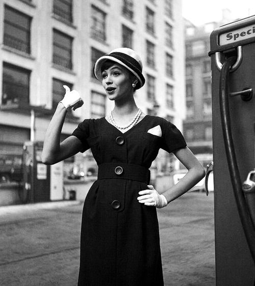 Actress Anna Karina in navy shantung dress topped with a hat by Cécile Billard, photo by Georges Dambier, ELLE, March 16, 1959