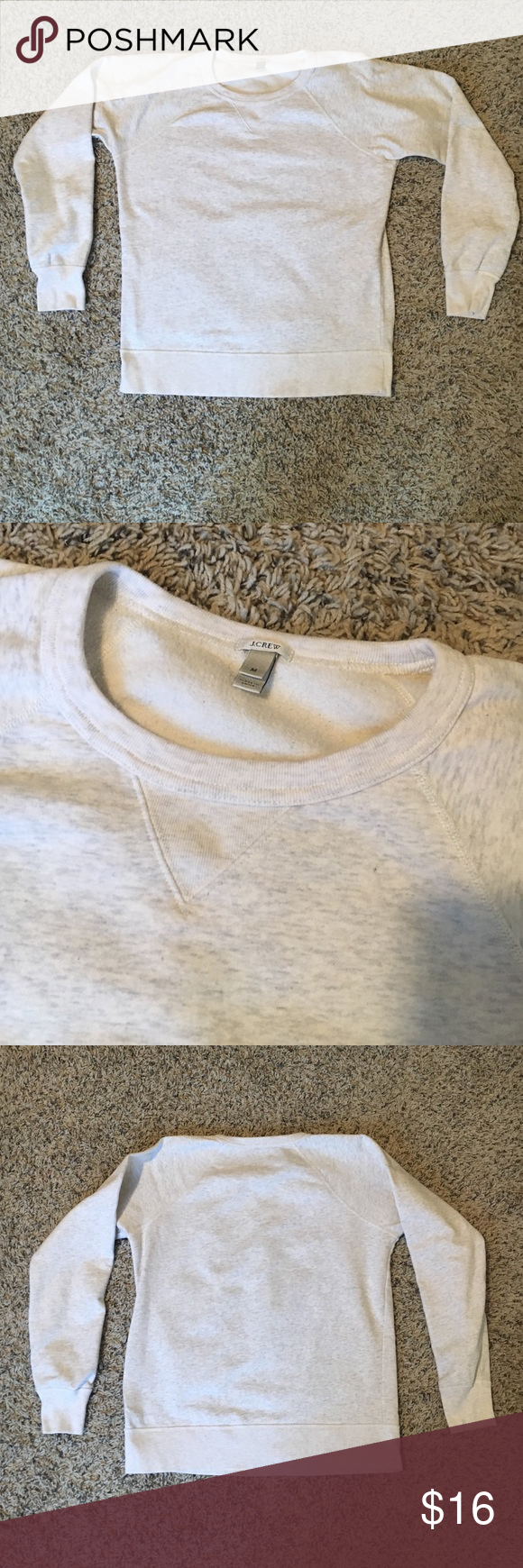 J. Crew Basic Light Gray Sweater Sz:M J. Crew Basic Light Gray Sweater Sz:M. Asking for my mother in law... This is shades of white and gray mixed so it appears a very light gray. V-stitched into the front collar. (100% cotton) machine wash. There is a very light brown makeup stain on the back where my finger is pointing. I washed it and it mostly came out, but there is one spot still left. Very faint though. J. Crew Sweaters Crew & Scoop Necks