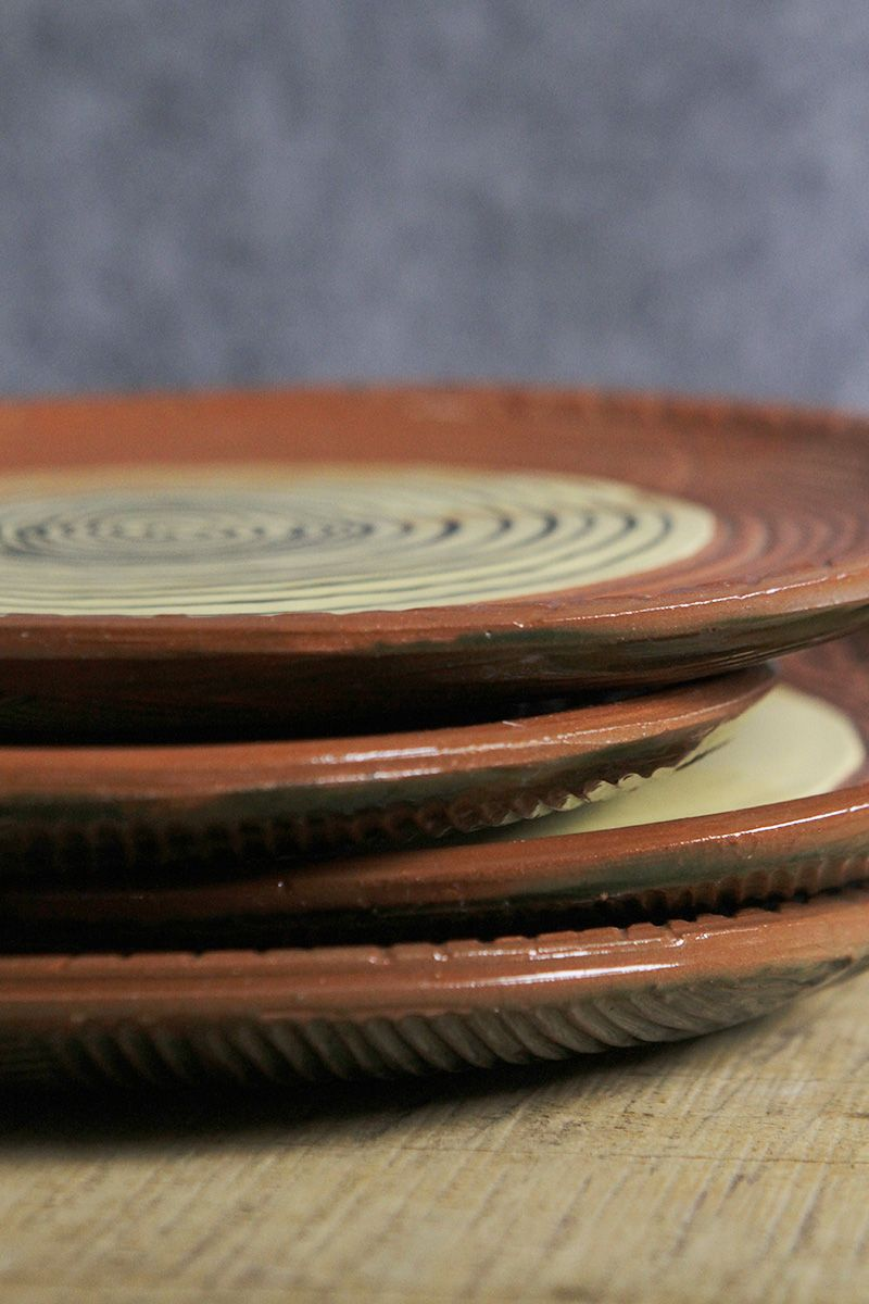 """Leyati is a Miwok name meaning """"shaped like an abalone shell."""" This small plate by ceramicist and painter Susan Hall of Point Reyes Station is thrown and then hand-painted. Earthy and rustic, with etched lines and a spiral motif that recalls tribal art, the Leyati Plate is ideal for a snack or side salad. Susan is inspired by the mystery of Northern Californian landscapes"""