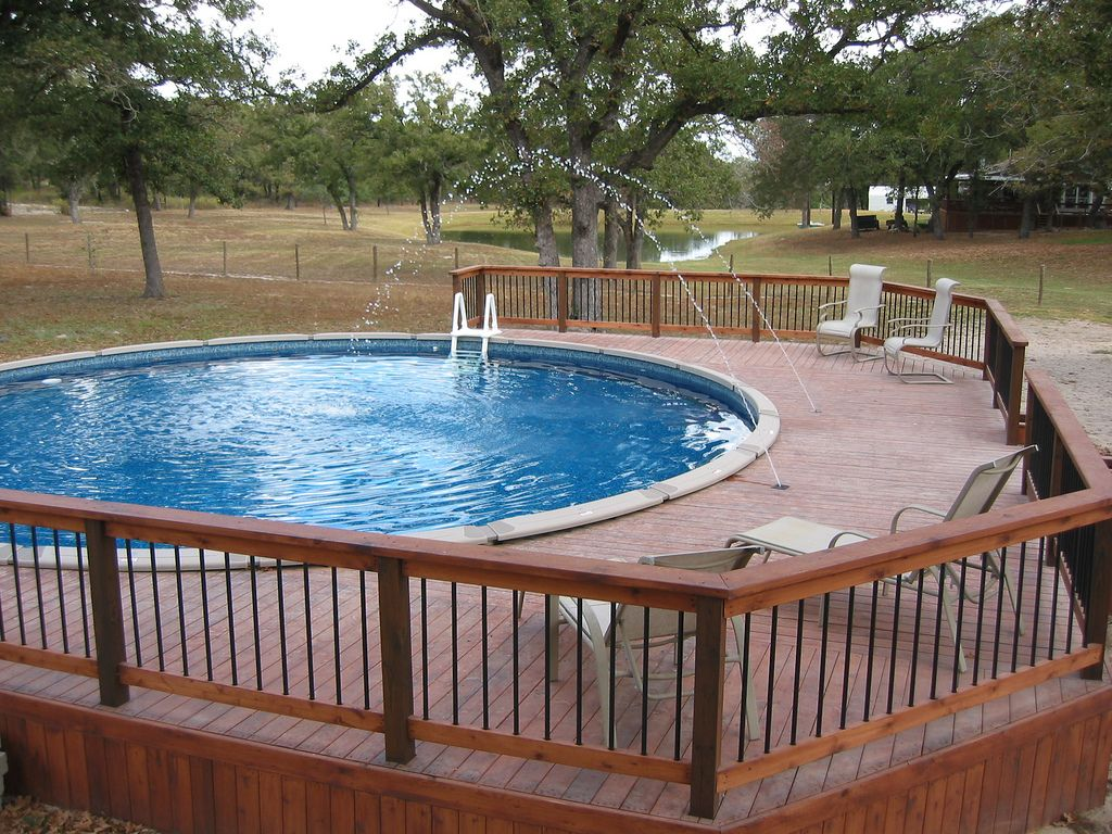 Above ground pool deck jets and dark blue liner lavernia for Above ground pool decks images