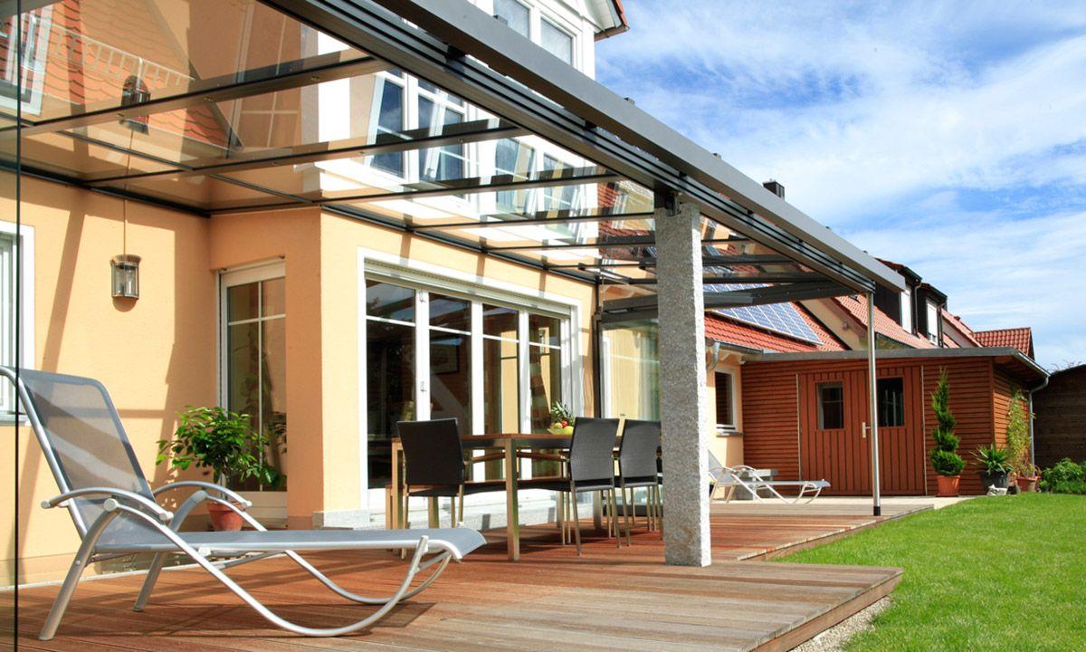 Terrassenüberdachung aus Alu und Glas mit GranitPfosten