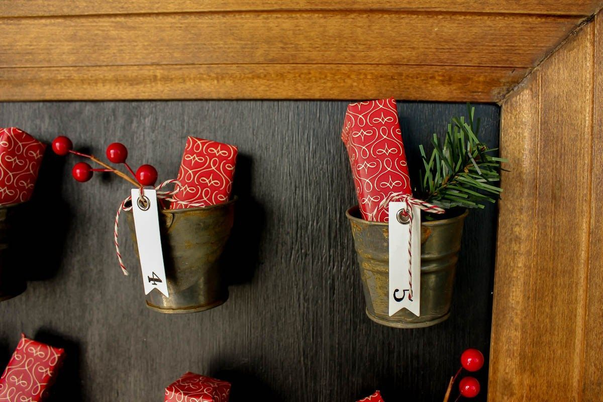 Pottery Barn Knockoff DIY Advent Calendar Tutorial #wineadventcalendardiy DIY Pottery Barn Knockoff Advent Calendar. Step-by-step tutorial with lots of details! | MakeAndDoCrew.com #wineadventcalendardiy