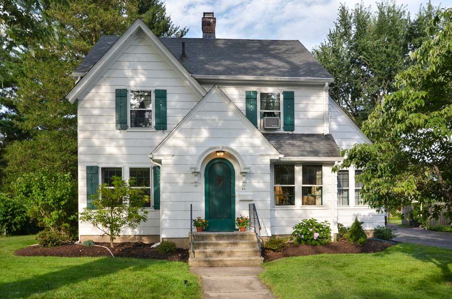 White House With Green Shutters And Arched Door Colonial