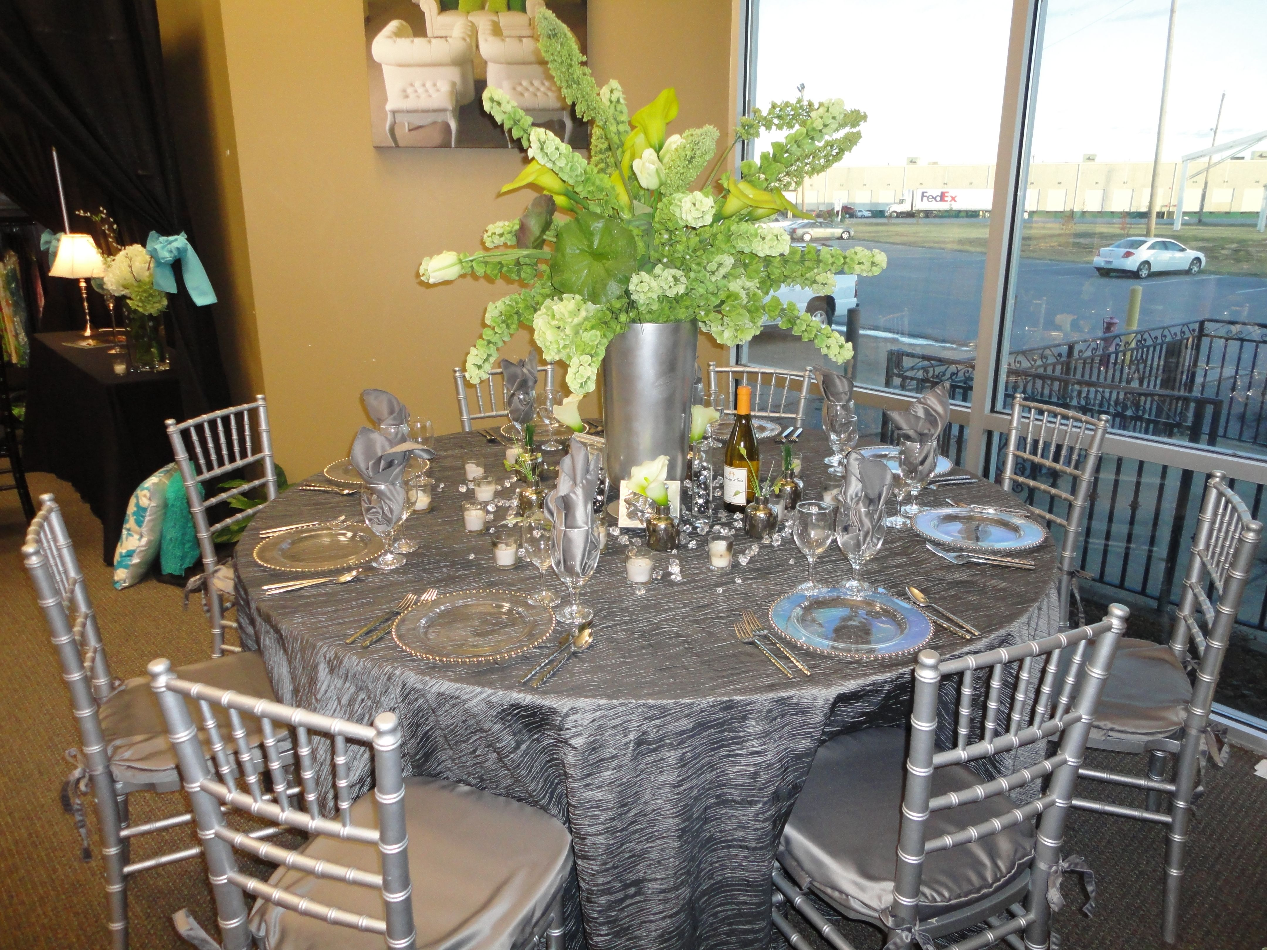 Silver Linens and Chiavari Chairs by Mahaffey Tent & Event Rentals