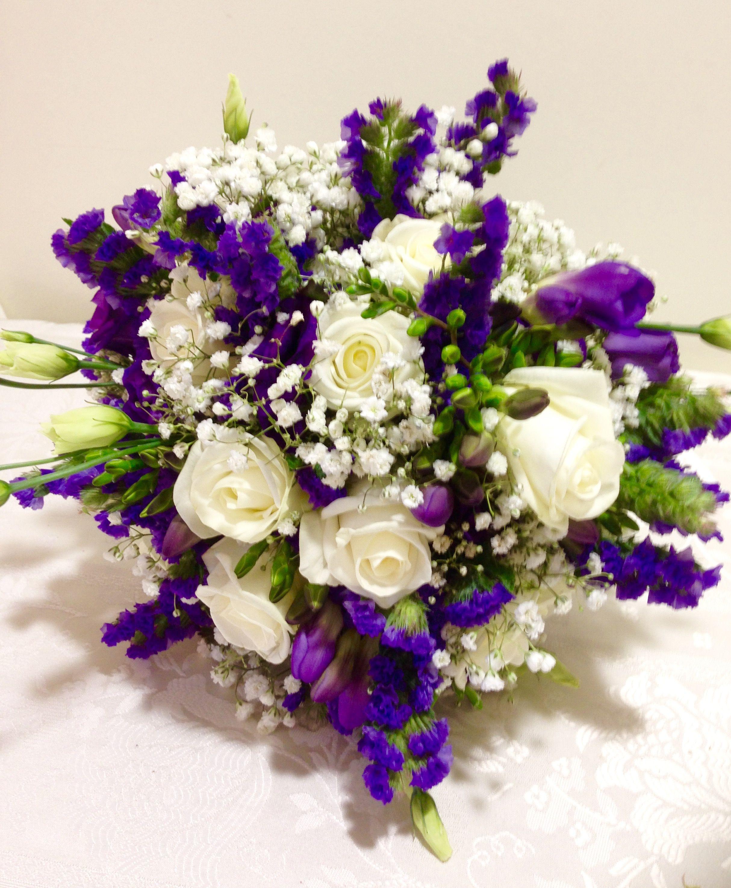 Cadburys Purple And Ivory Brides Handtied Using Akito Roses