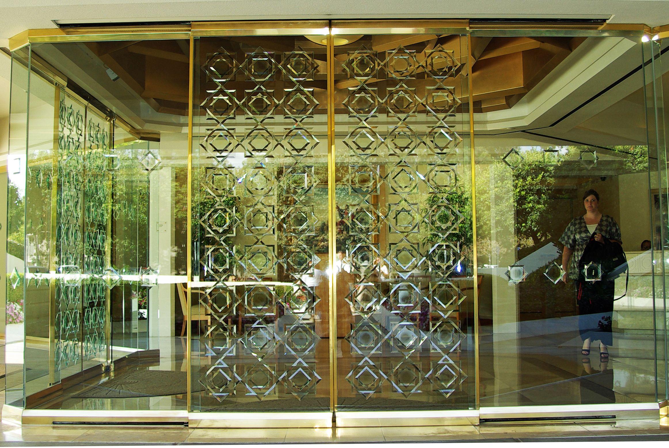 San diego lds temple glass front doors seal of melchizedek symbol san diego lds temple glass front doors seal planetlyrics Images