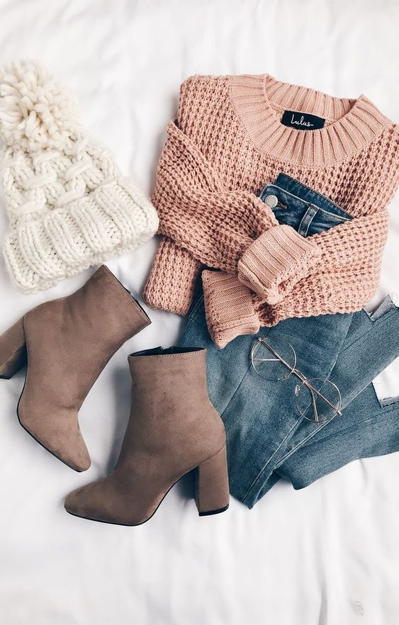 Blush pink sweater with denim jeans and brown boots. Topped