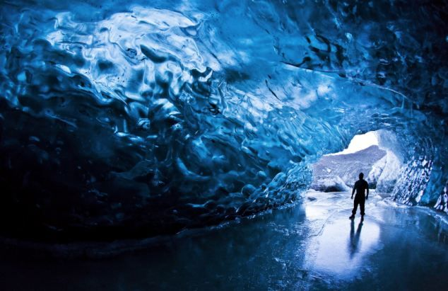 ice cave like in the children's book Very Last First Time by Jan Andrews ... These breathtaking pictures show the ethereal beauty of the ice caves that lie deep below the surface of Europe's largest glacier. Skarphedinn Thrainsson risked his life to capture the magnificent images at -120C under Vatnajokull in southern Iceland.