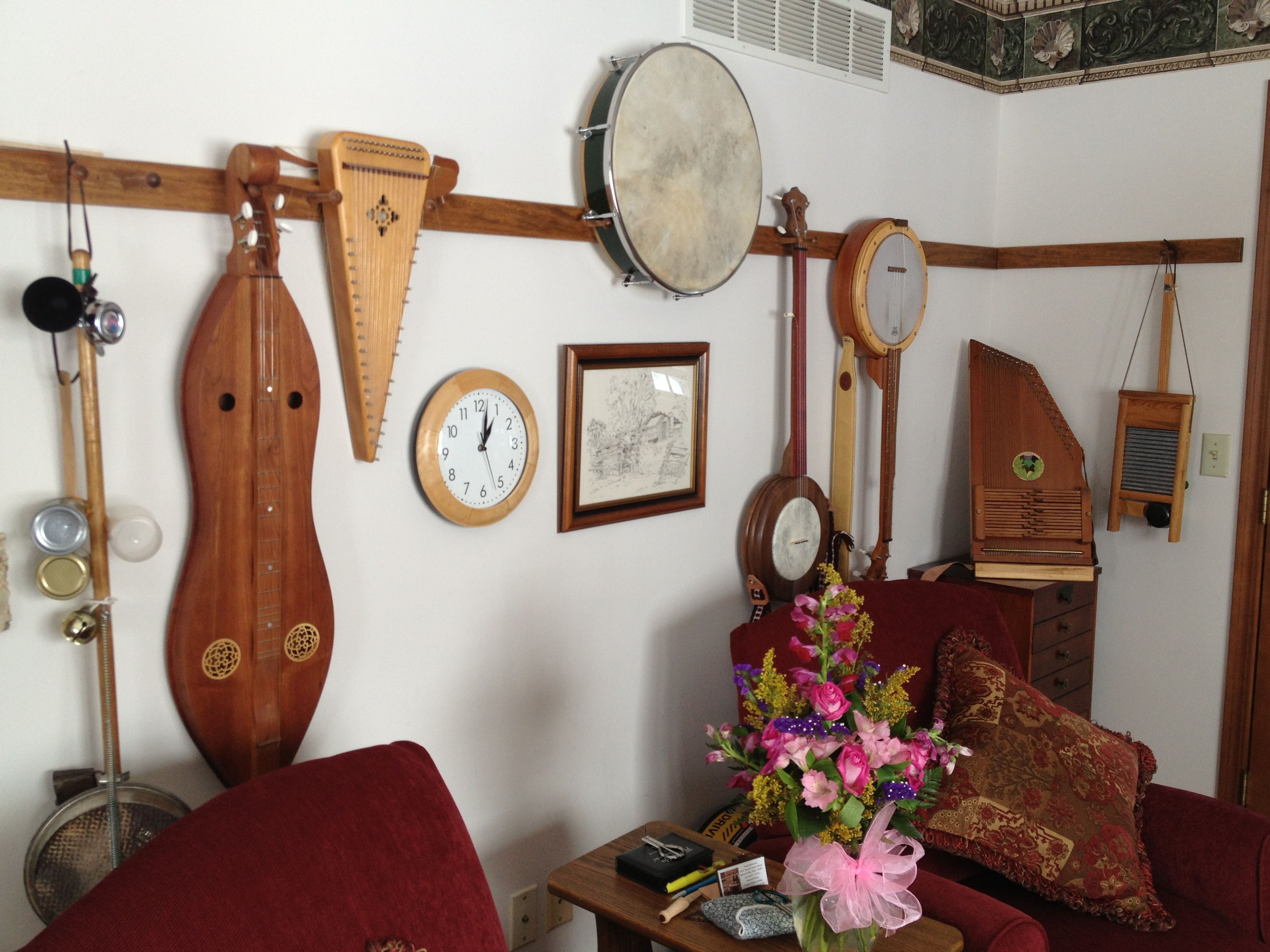 Display Of Musical Instruments Above Couch Decor Room