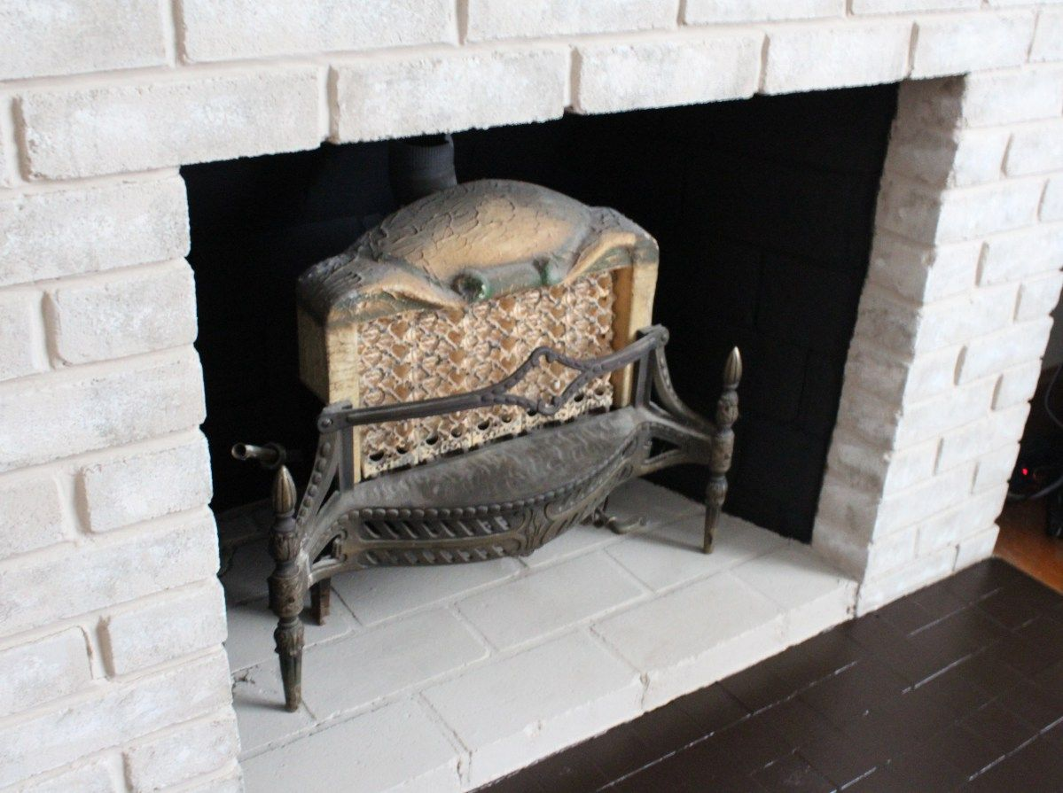 Fireplace makeover painting the firebox and mantel mantels