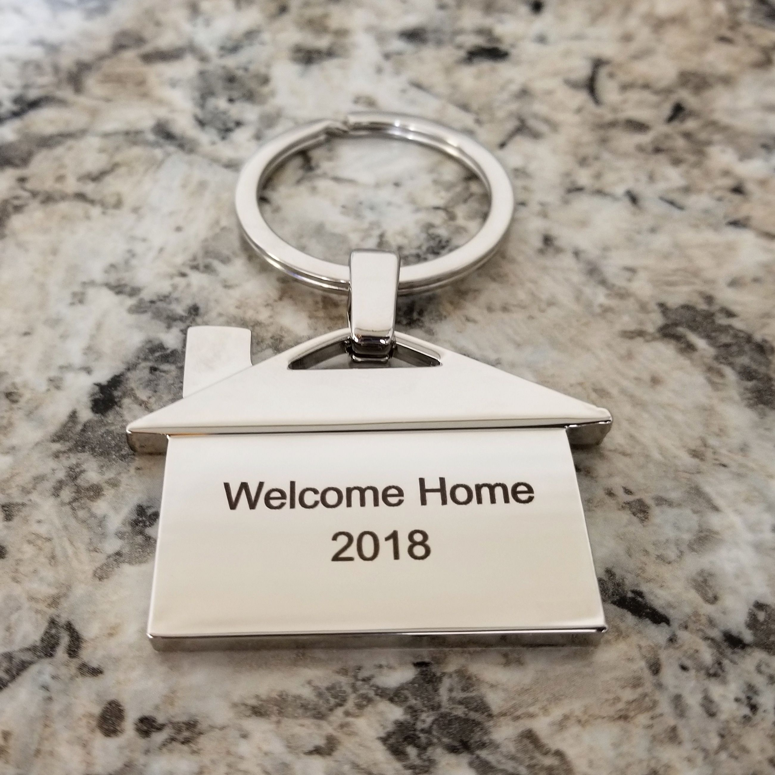 WELCOME HOME! Custom engraved keychains for meaningful Real