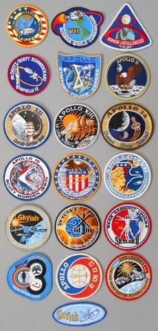 APOLLO, SKYLAB, and ASTP LION BROTHERS CREW MISSION EMBLEMS.
