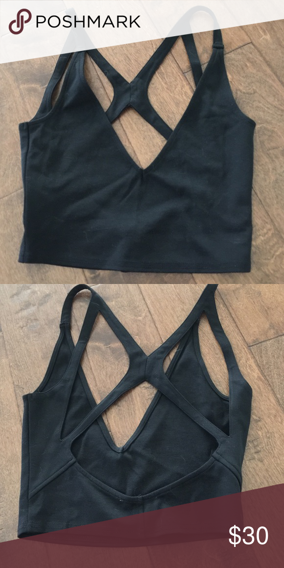 Urban Outfitters Strappy Crop Top NWOT Urban Outfitters Strappy Crop Top NWOT by Sugalips. Size small. New never worn. Tag is cut to prevent store return. Urban Outfitters Tops Crop Tops
