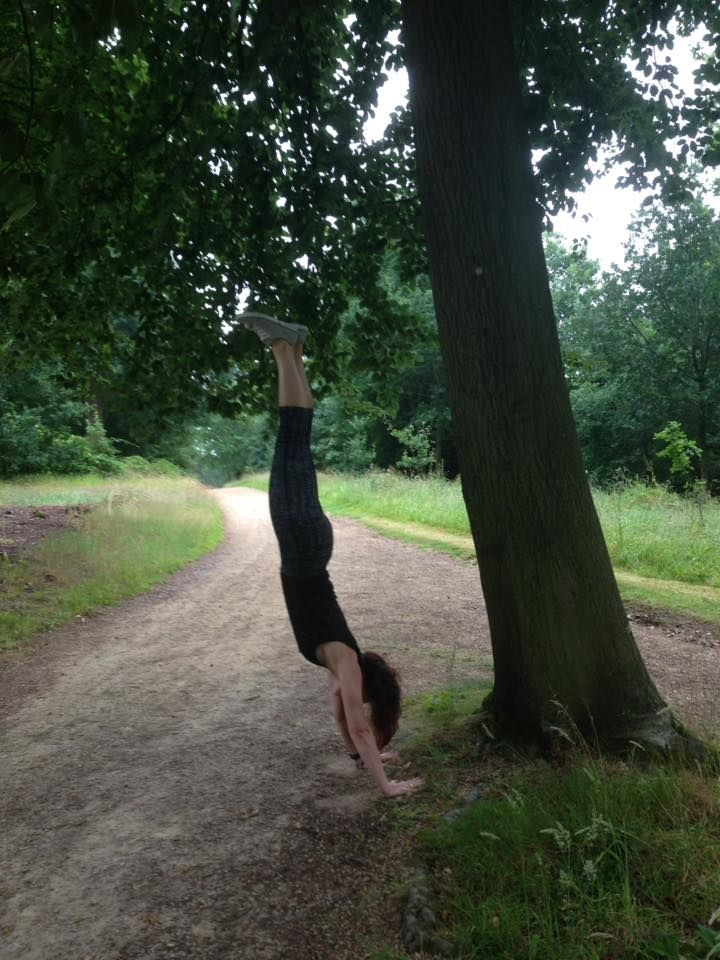 yoga helps to connect with nature. handstand