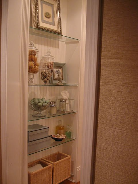 glass shelves in bathroom - use wicker baskets here instead