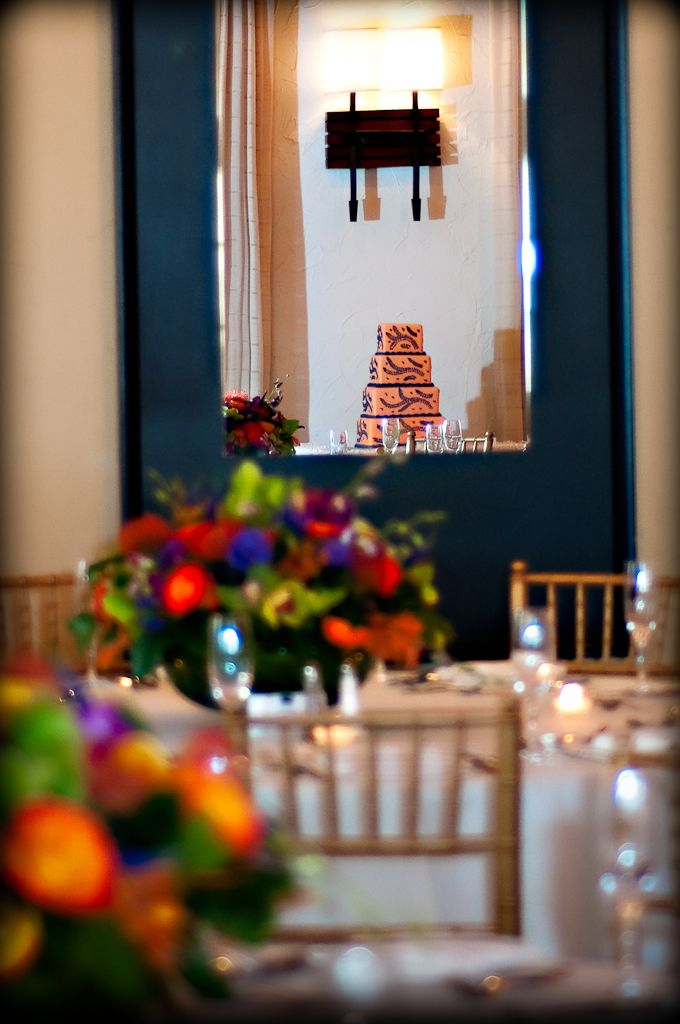 a mouth full of color! this shot of the wedding cake in the mirror and the flowers makes my mouth water beautiful set up        Make your dream wedding come true:                     1-866-383-6810 #dreamwedding #keywestwedding #dayofwedding #weddingplannerkeywest #planmywedding #wedding #fantasywedding #beachwedding