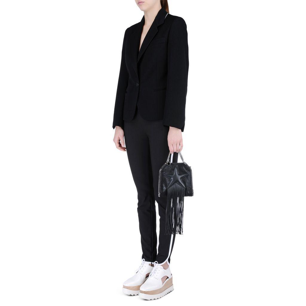 Как и с чем носить базовые черные брюки