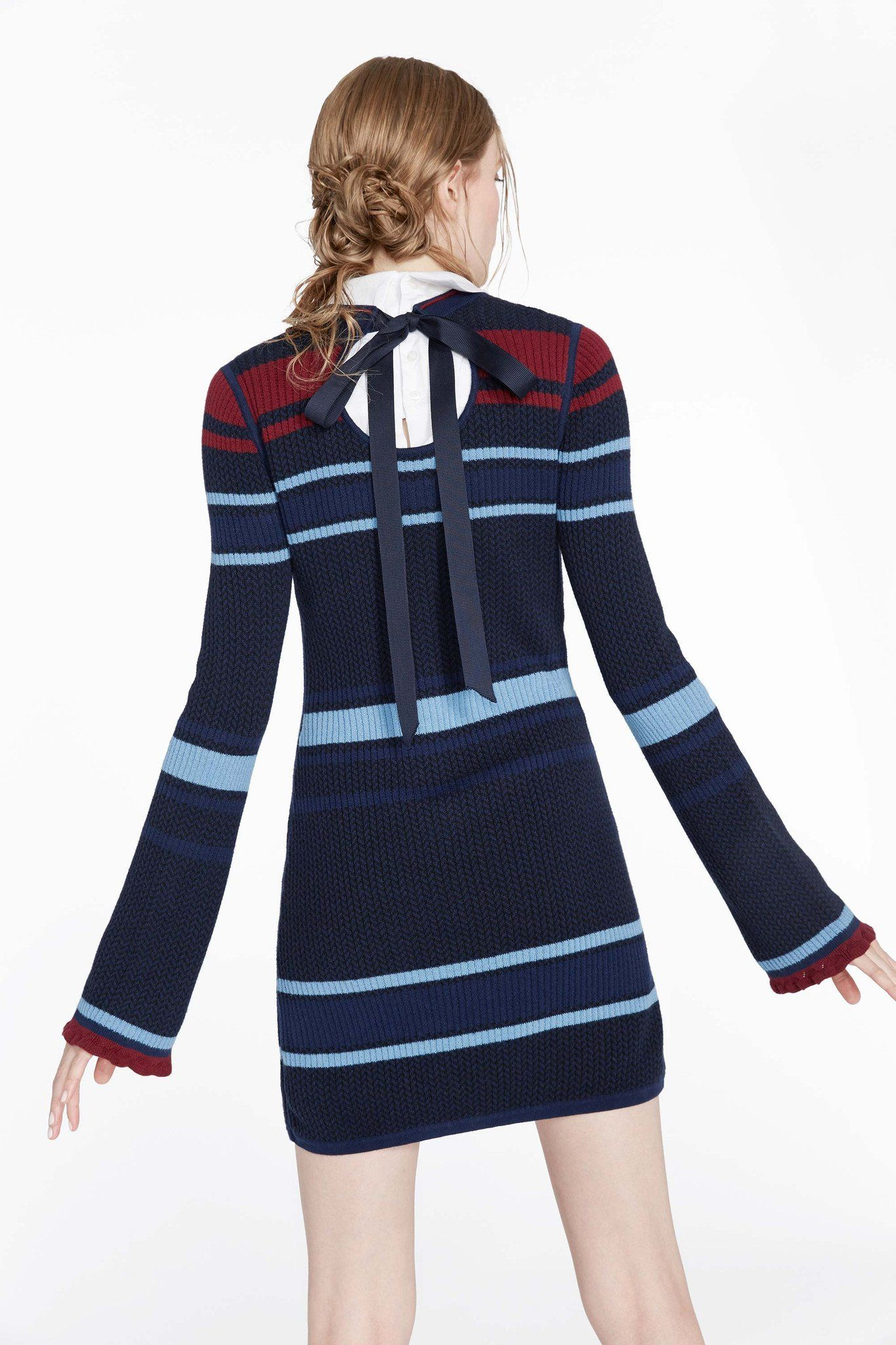 Ever wake up on a chilly morning and wish you could just wear your robe to work? Yeah, us too. That's why Misha designed this blue striped sweater dress.