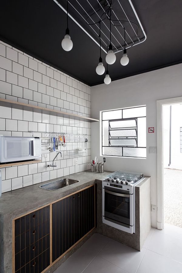 for the dirty kitchen. concrete counter top, subway tiles with